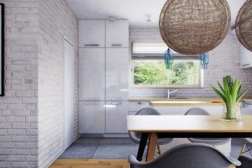 Кухня, открытая в гостиную, позволяет сохранить большое пространство, что является характерной чертой интерьеров в стиле лофт.