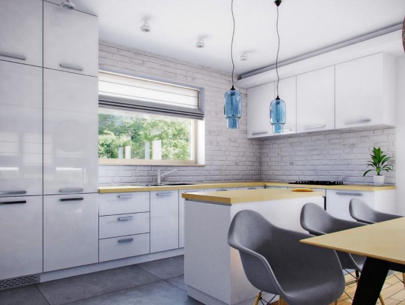 Слишком много белой поверхности может показаться скучной. Чтобы придать белой стене характер, стоит отделать ее кирпичом.