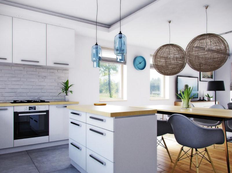 Яркий дизайн интерьера дополнен привлекательными элементами отделки: кирпичом, бетоном и деревом.